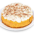 Pumpkin Cheesecake with Whipped Cream and Cinnamon