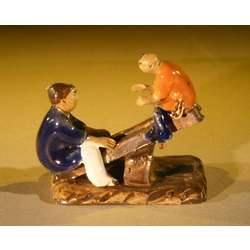 Two Boys on a See-Saw Ceramic Figurine