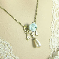 Blue Rosette Necklace with Cherub