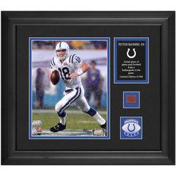 Peyton Manning Framed Photograph with Piece of Game Used Ball