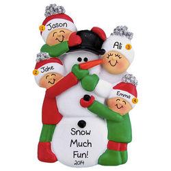 Family of Four Building Snowman Christmas Ornament