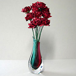 Red Paper Roses in a Colorful Glass Vase