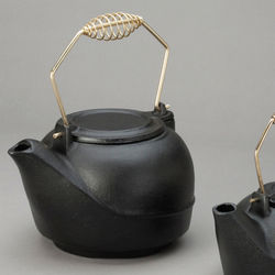 Cast Iron Steamer Tea Kettle with Gold-Colored Metal Coil Handle