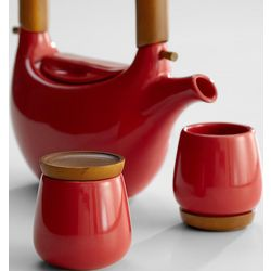Red Ceramic Teapot and Teacups with Wooden Saucers
