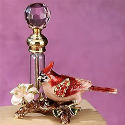 Decorative Perfume Bottle with Red Cardinal and Flower Display