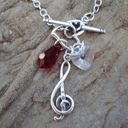 Bella's Lullaby Charm Necklace in Sterling Silver