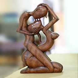 Upside-Down Kissing Wood Statuette