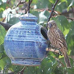 Small Bird Pottery Seed Feeder