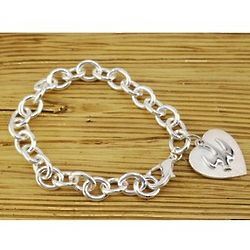 Deluxe Bracelet With Heart and Dove Charms