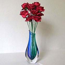 Red Paper Roses in Blue Vase