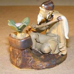 Man with Bonsai Tree and Brush Figurine