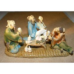 Three Men Sitting at a Table Figurine