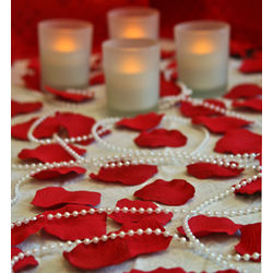 Romantic Room of Rose Petals, Candles and Pearl Beads