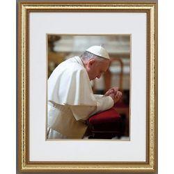 Pope Francis Kneeling in Prayer Framed Print