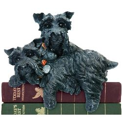 Pair of Resting Baron Pups on Books with Blackened Finish