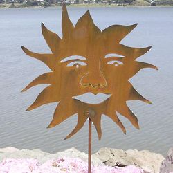 Smiling Sun Metal Garden Sculpture with Rust Patina