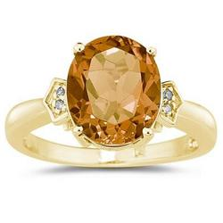 Oval Cut Citrine and Diamond Ring in Yellow Gold